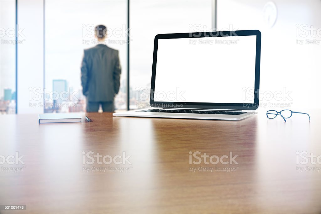 Laptop and businessman stock photo