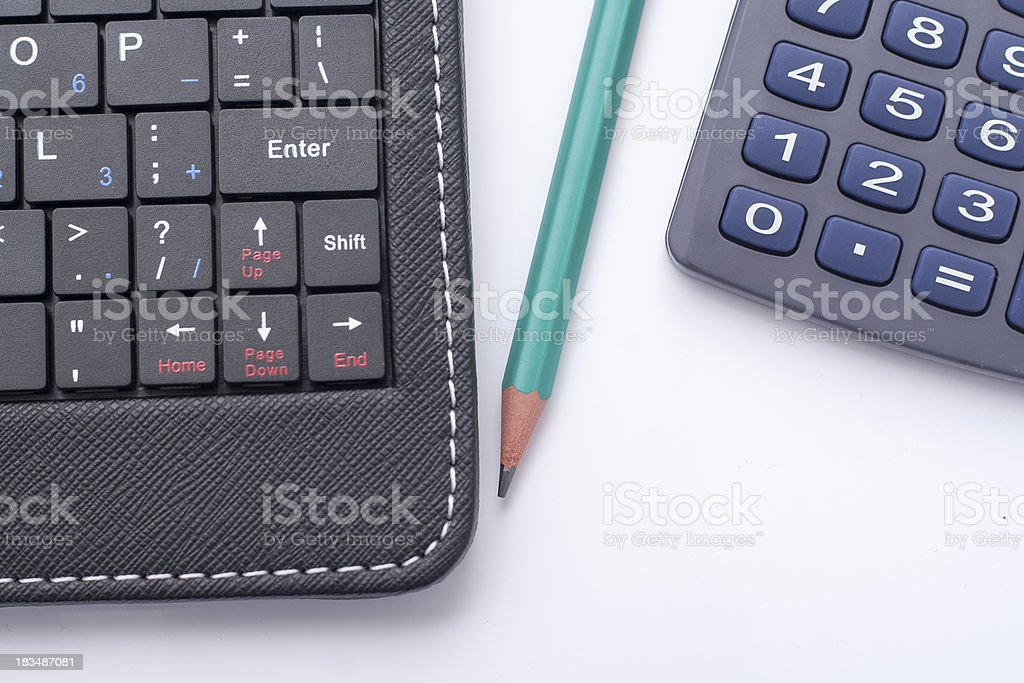 Laptop and calculator on table royalty-free stock photo