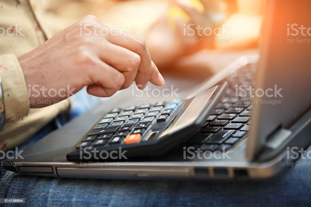 Laptop And Calculator stock photo