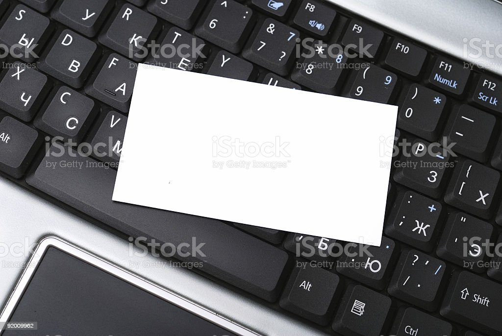 Laptop and calling card stock photo