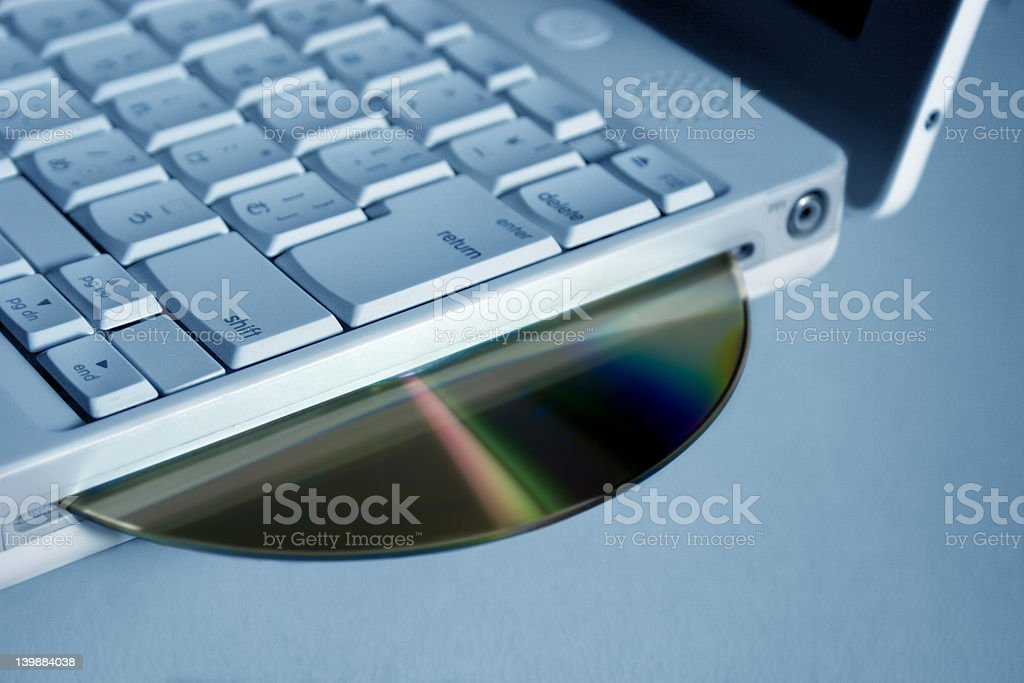 laptop and CD royalty-free stock photo