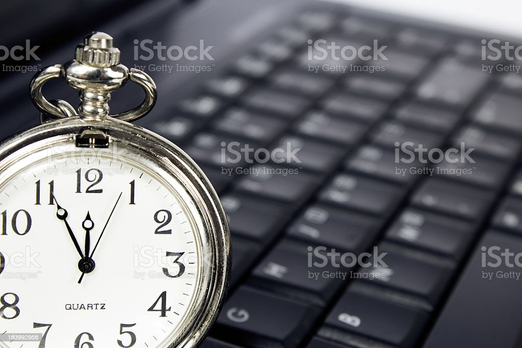 Laptop and clock royalty-free stock photo