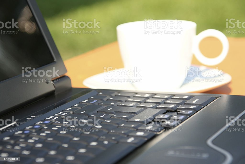 laptop and coffee cup in nature royalty-free stock photo