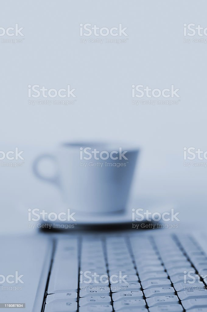 Laptop and coffee mug royalty-free stock photo