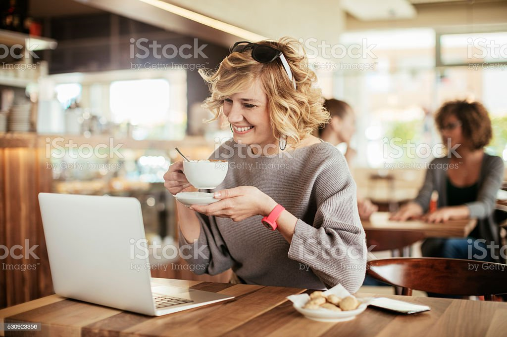 Laptop and coffee stock photo