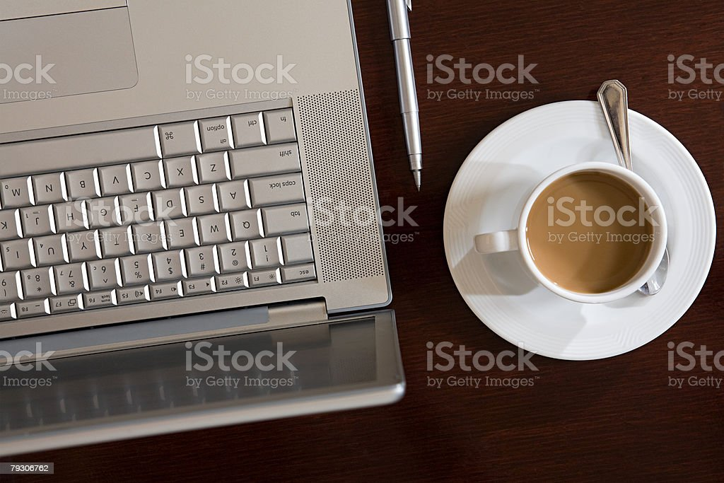 Laptop and coffee royalty-free stock photo