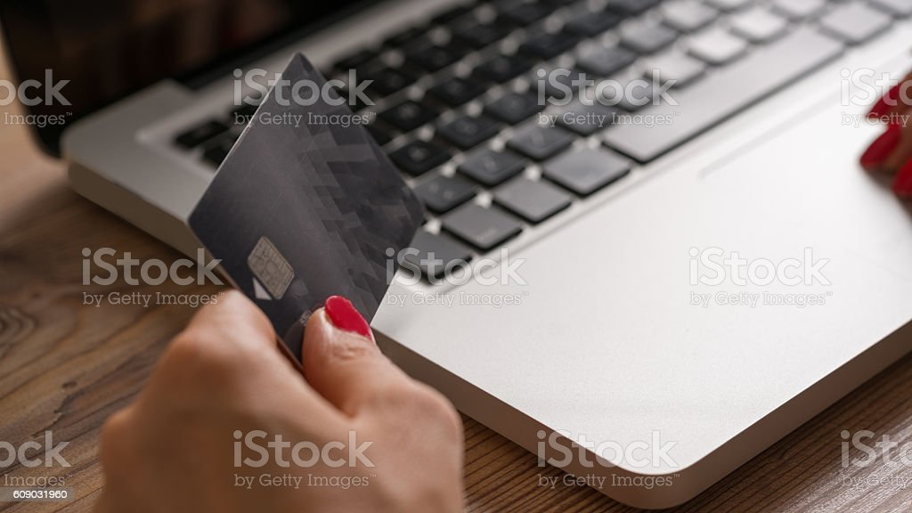 Laptop and credit kart stock photo