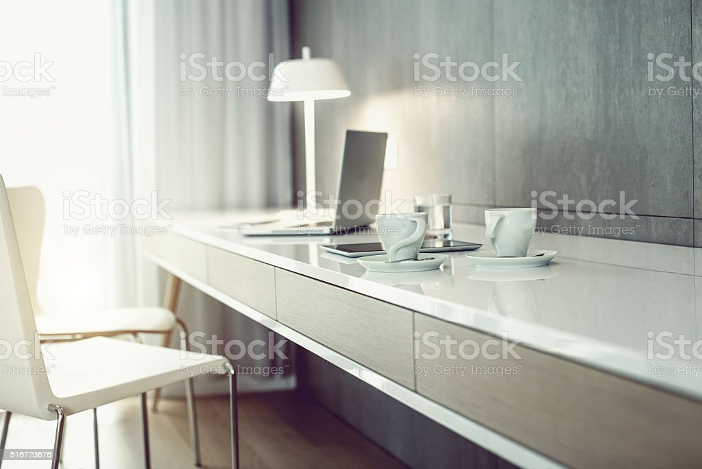 Laptop and digital tablet on a table workplace stock photo