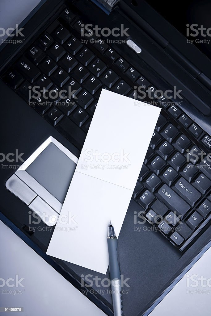 Laptop and empty notepad stock photo