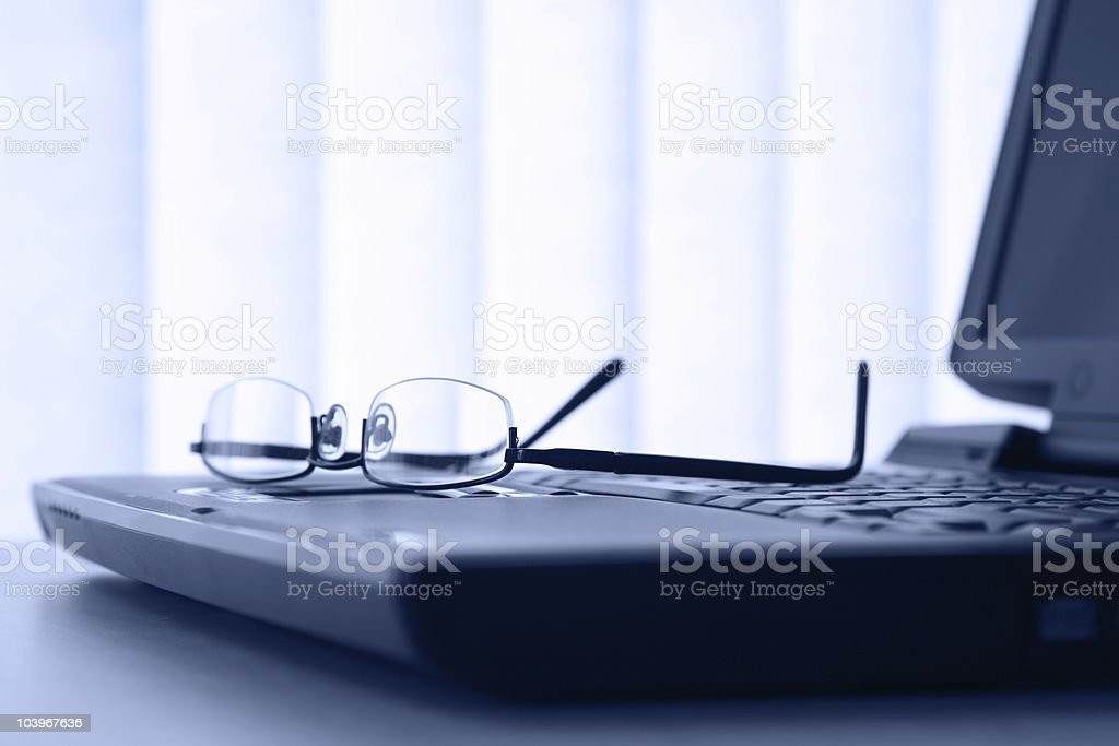 Laptop and Glasses royalty-free stock photo