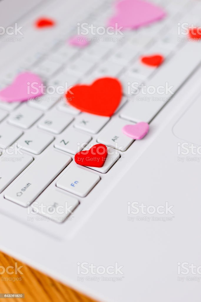 Laptop and heart stock photo