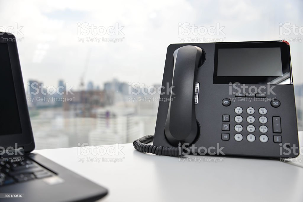 Laptop and IP Phone stock photo