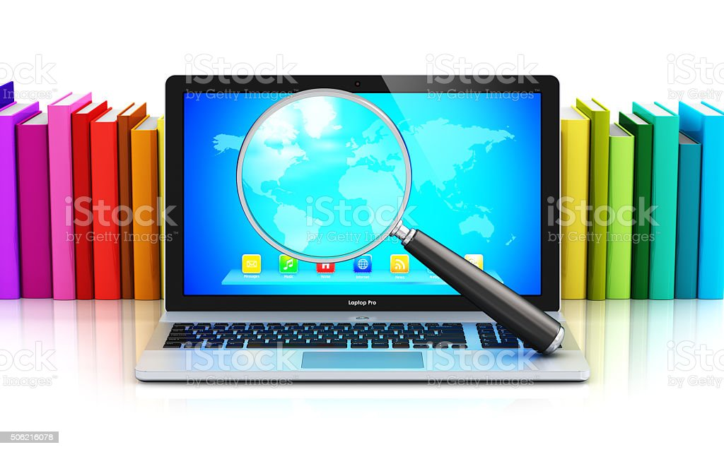 Laptop and magnifying glass in front of row of color books stock photo