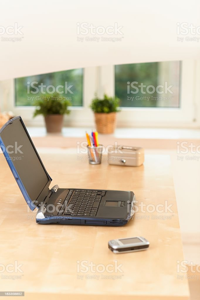 Laptop and mobile phone on desk royalty-free stock photo