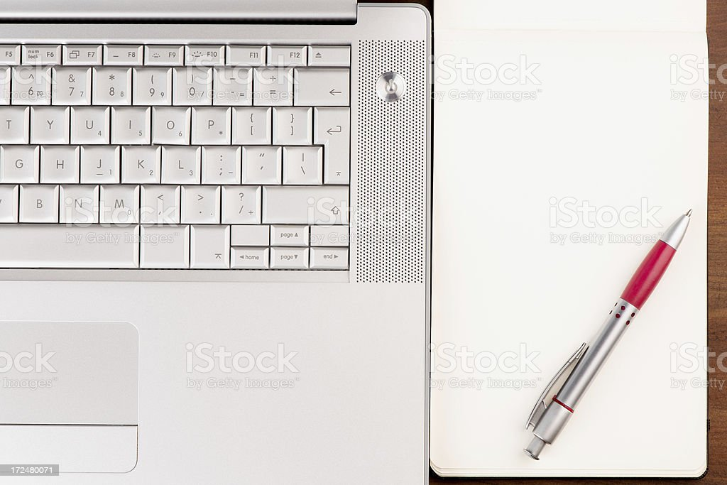 Laptop and note pad royalty-free stock photo