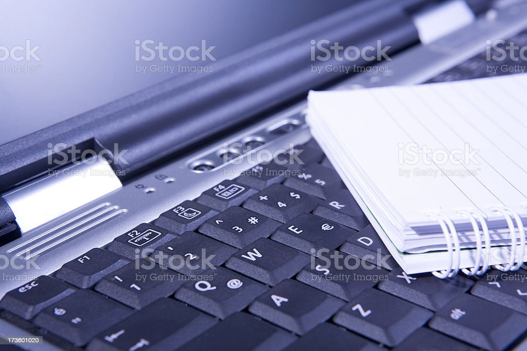 laptop and notepad stock photo