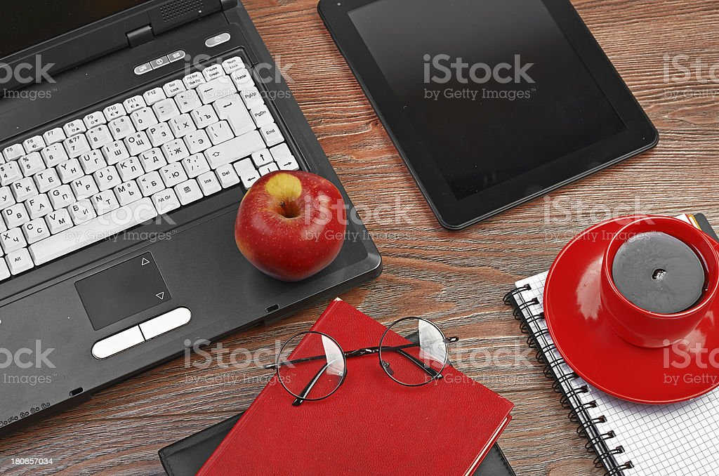 Laptop and office supplies on wooden table royalty-free stock photo