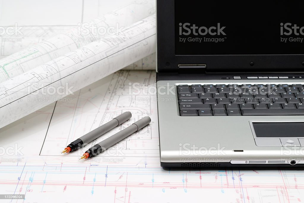 Laptop and plans on the table royalty-free stock photo