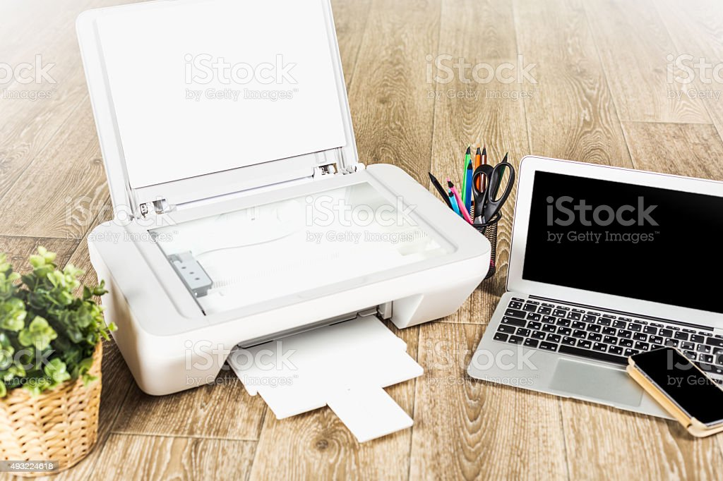 Laptop and printer stock photo