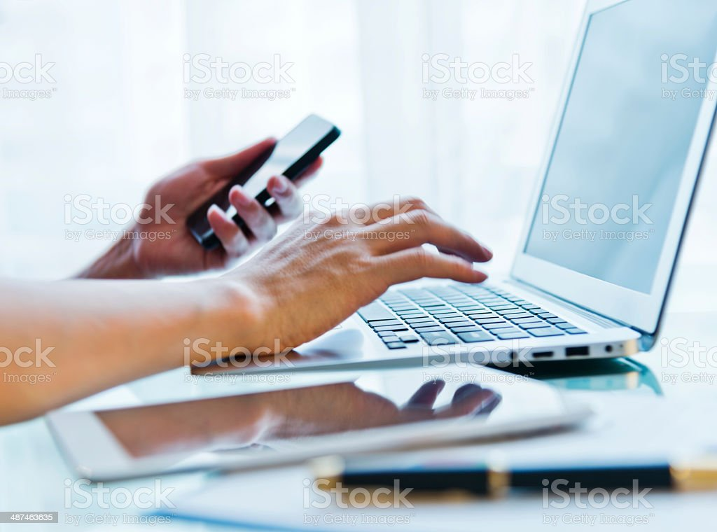 Laptop and telephone stock photo