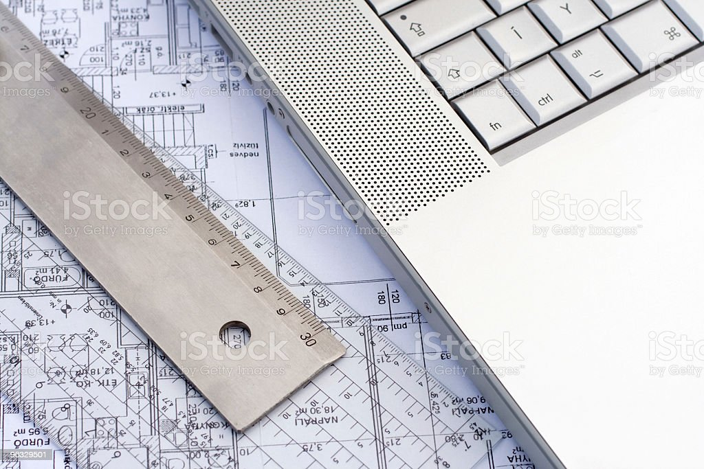 Laptop and tools on a blueprint royalty-free stock photo