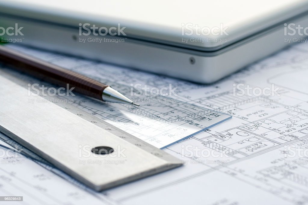 Laptop and tools on a ground plan royalty-free stock photo