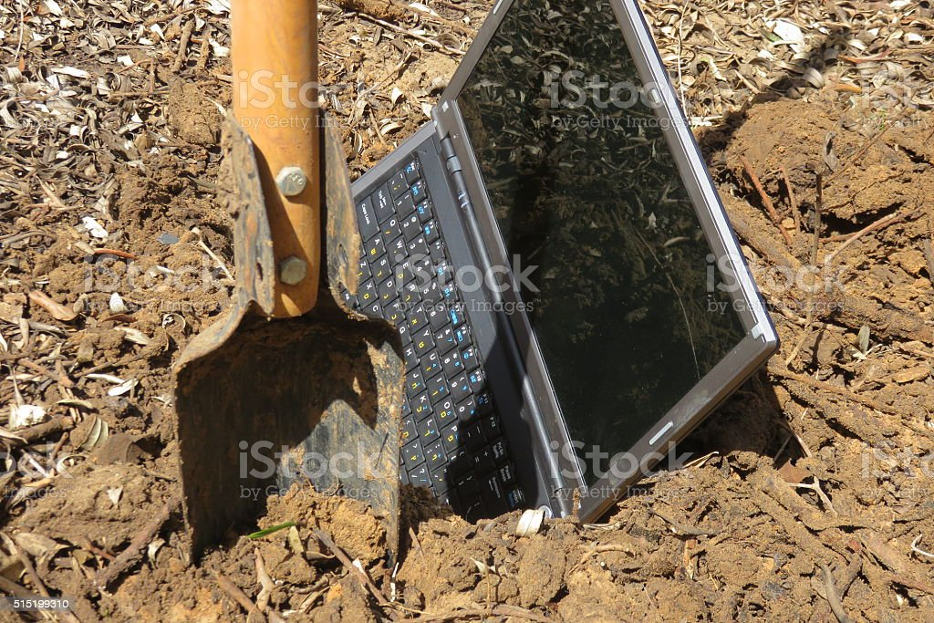 Laptop Being Buried stock photo