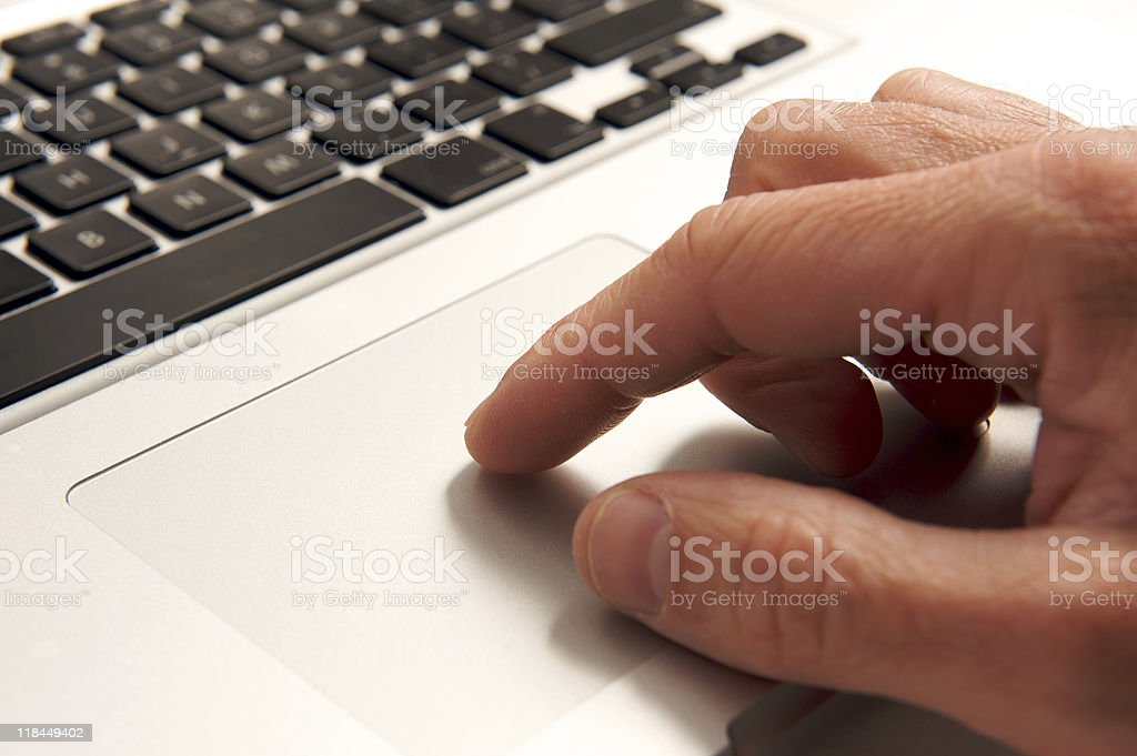Laptop close up with hand royalty-free stock photo