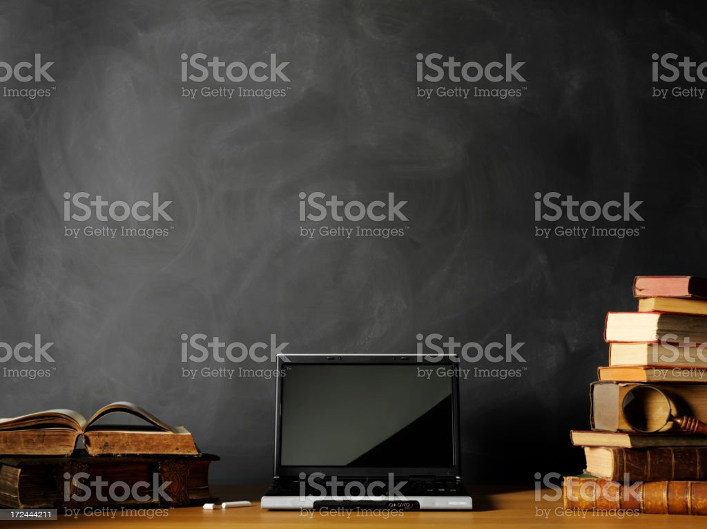 Laptop Computer and Antique Books in a Classroom royalty-free stock photo