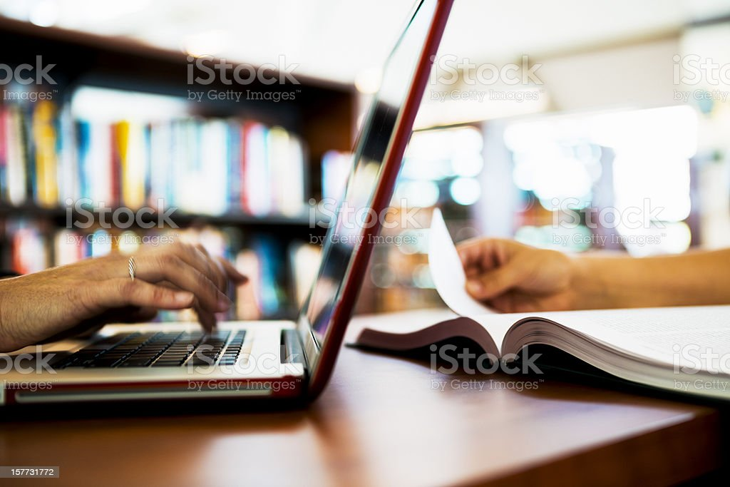 Laptop Computer and Book on Table stock photo