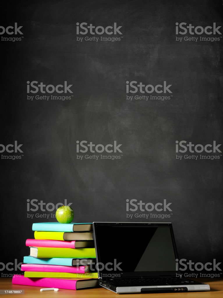Laptop Computer and Books on a School Desk royalty-free stock photo