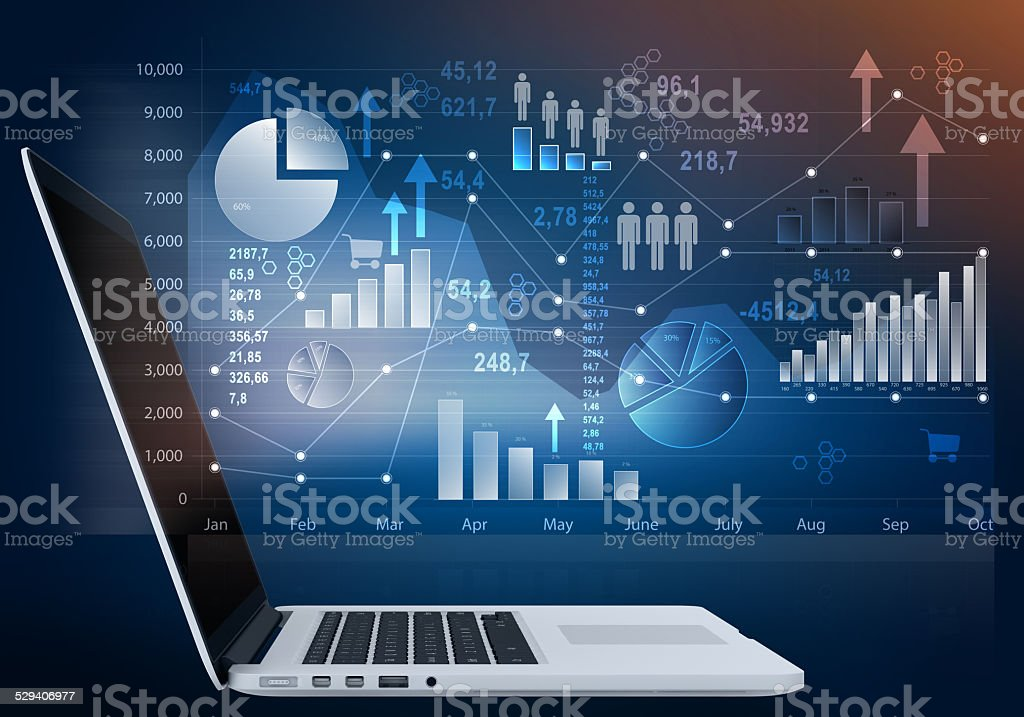 laptop computer and outside touch screen with chart icon. stock photo