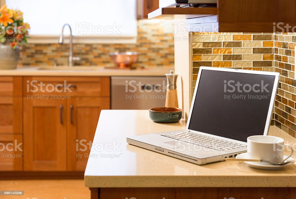 Laptop computer in contemporary upscale home kitchen interior stock photo