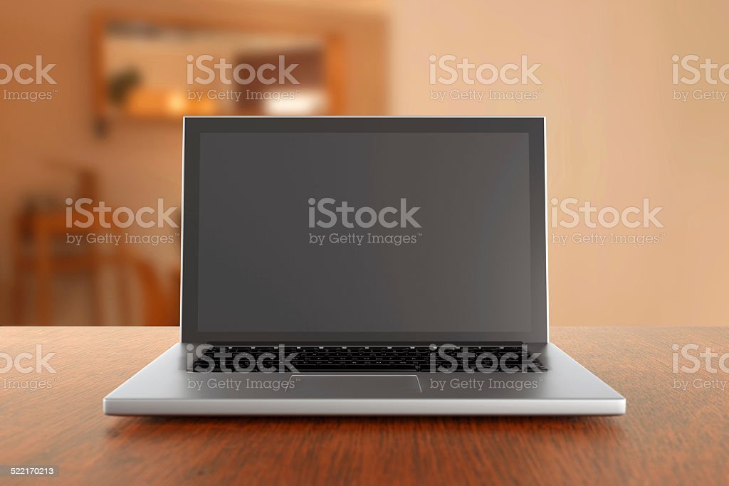 Laptop computer on a table inside apartment stock photo