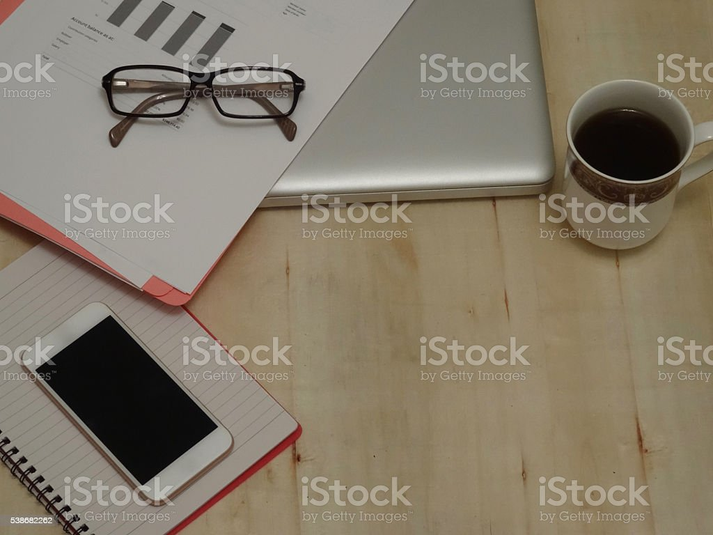 Laptop computer on a wooden surface with copy space stock photo
