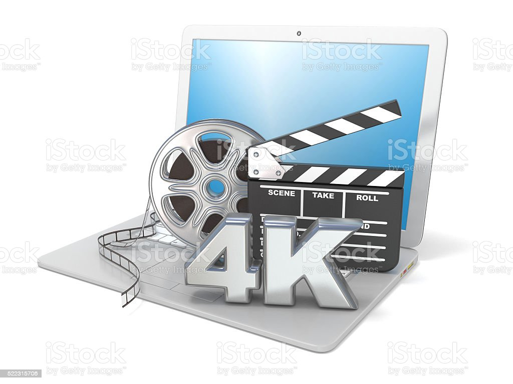 Laptop, film reels, movie clapper board and 4K video icon stock photo
