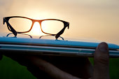 Laptop & glasses during sunset