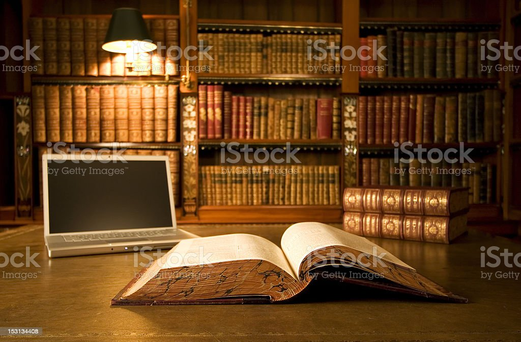 Laptop in classic library stock photo
