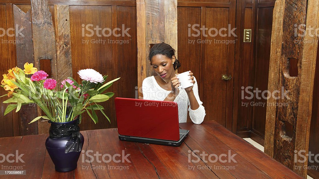 laptop in dining room stock photo