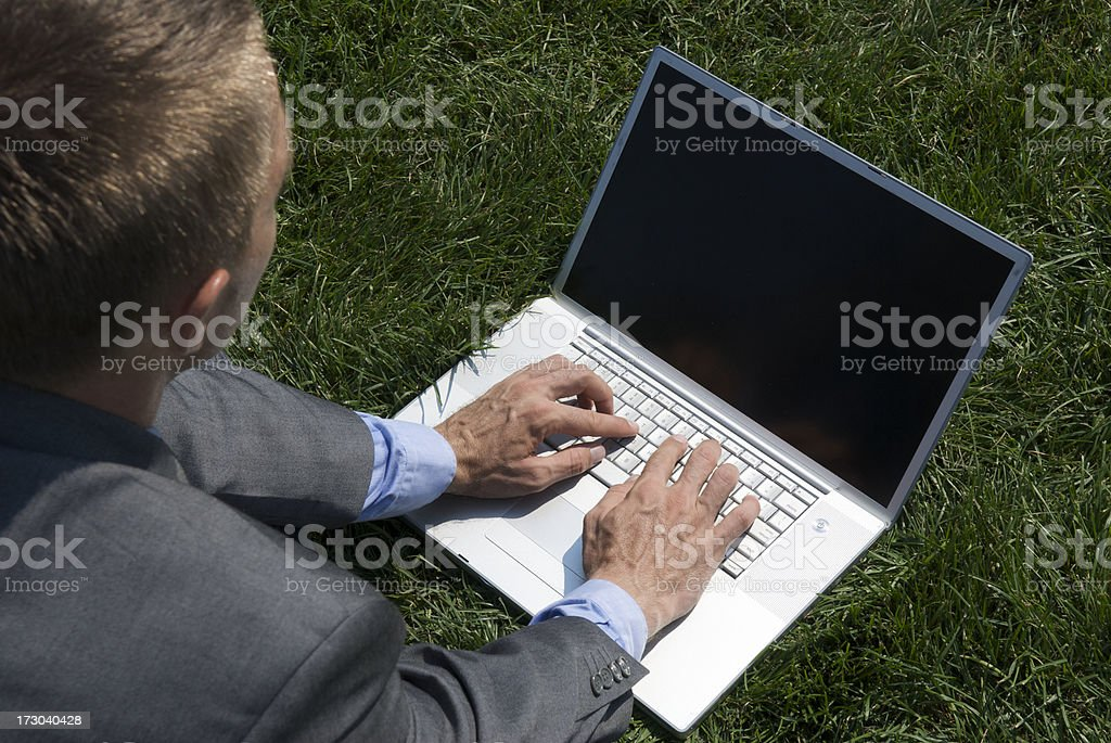 Laptop in the Grass royalty-free stock photo