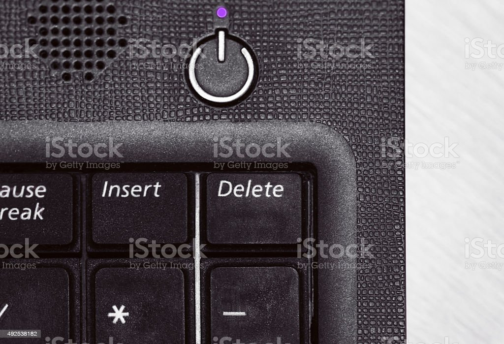 Laptop keyboard with delete button in black and white stock photo