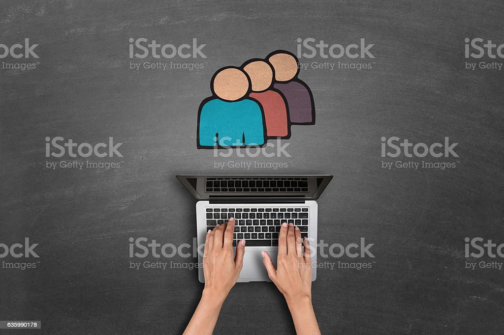 laptop keypad in front of contact book icon. stock photo