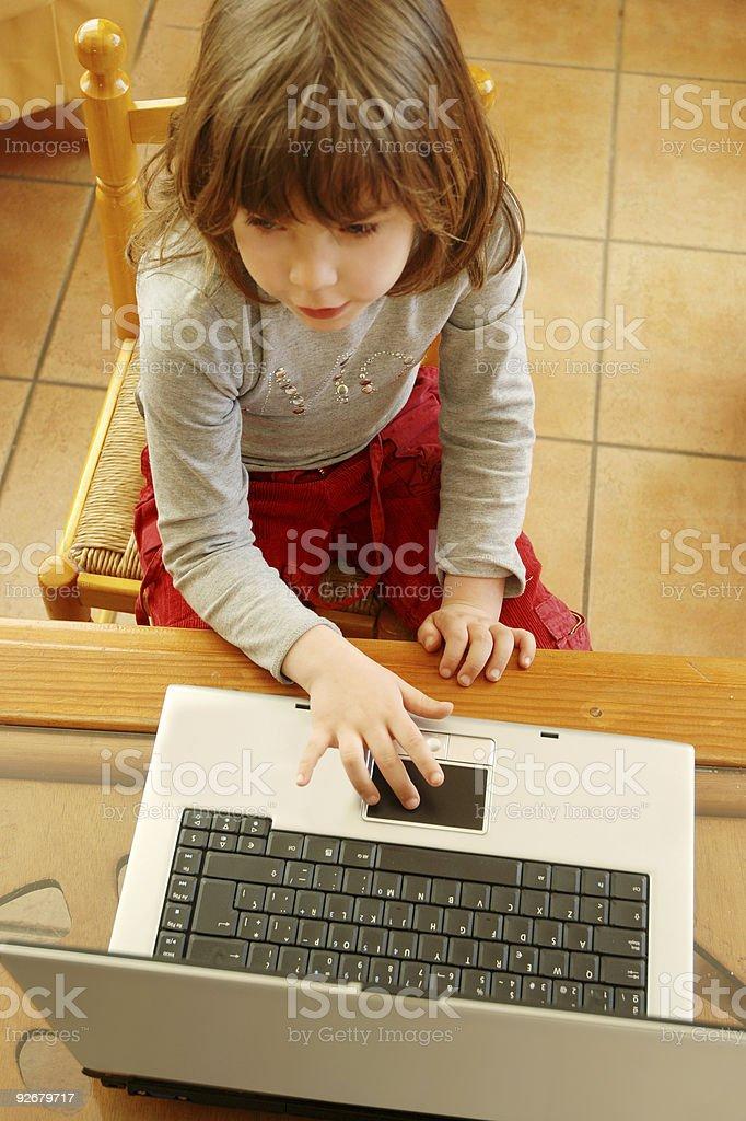 Laptop little user. stock photo