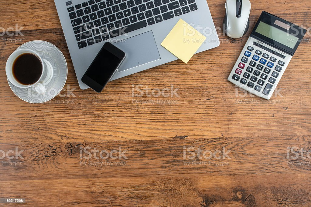 Laptop, Mobile Phone and coffee cup on work desk stock photo