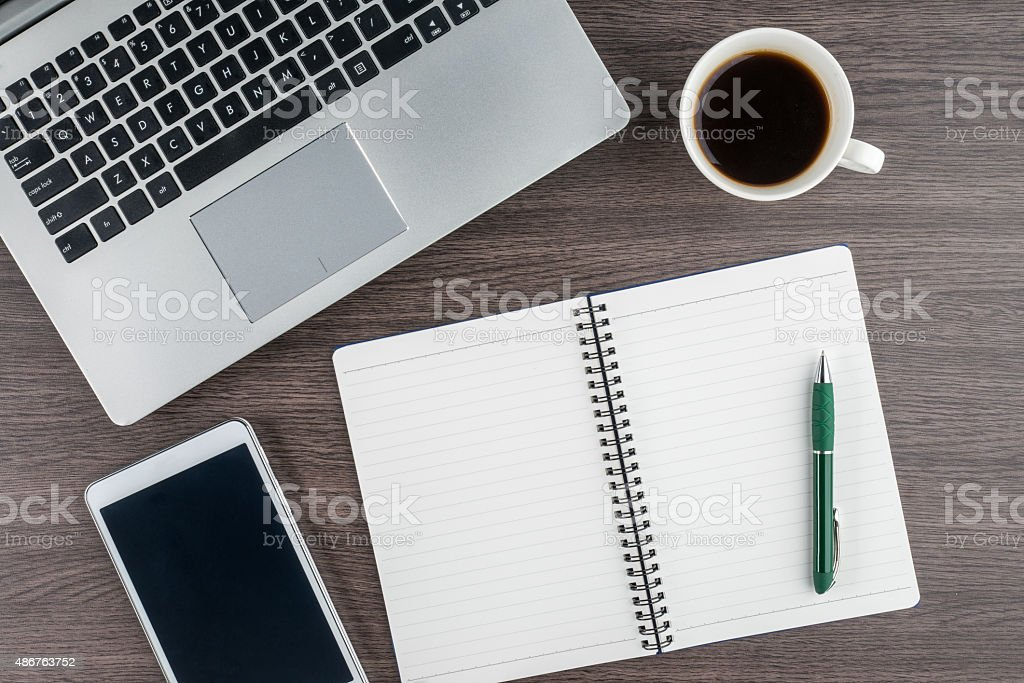 Laptop, notebook, Tablet and coffee on work desk stock photo