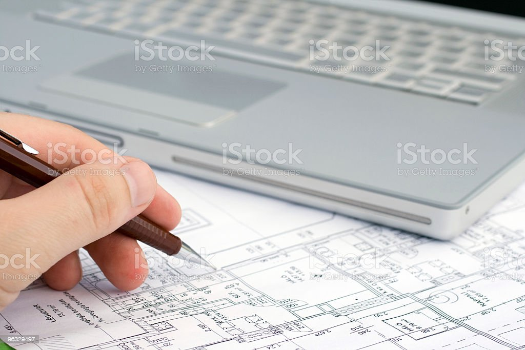 Laptop on a ground plan royalty-free stock photo