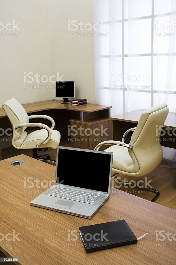 laptop on a table royalty-free stock photo