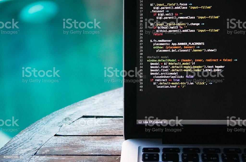 laptop on a wooden table stock photo