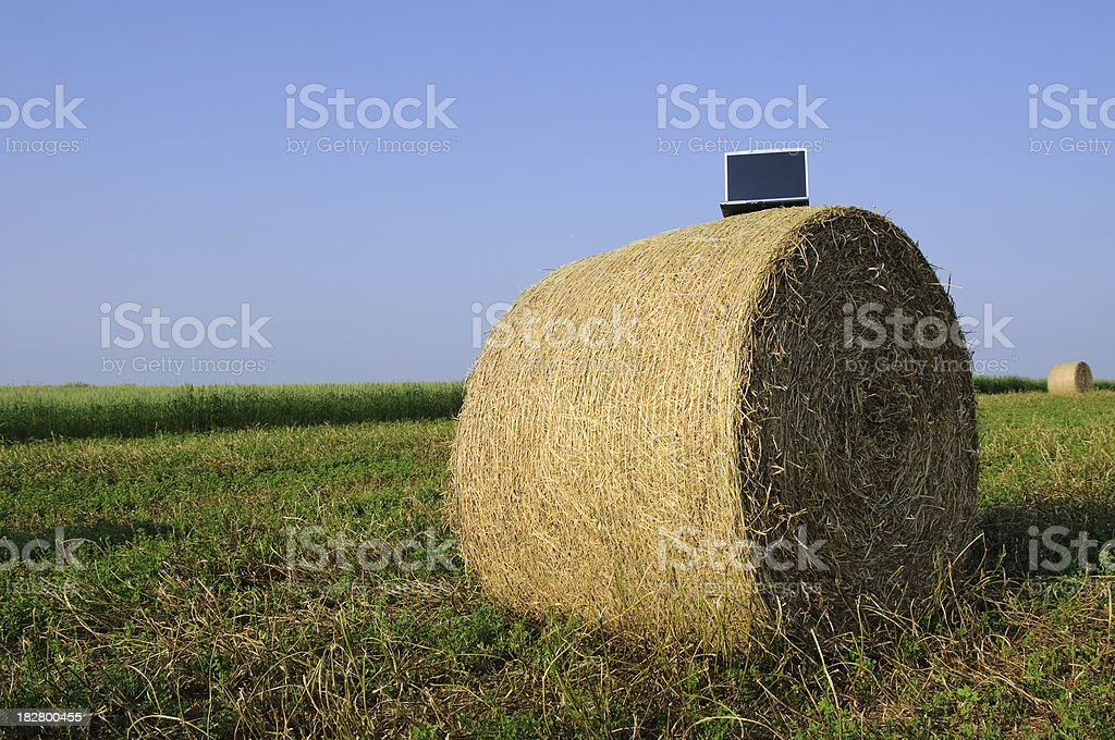 Laptop on bale royalty-free stock photo