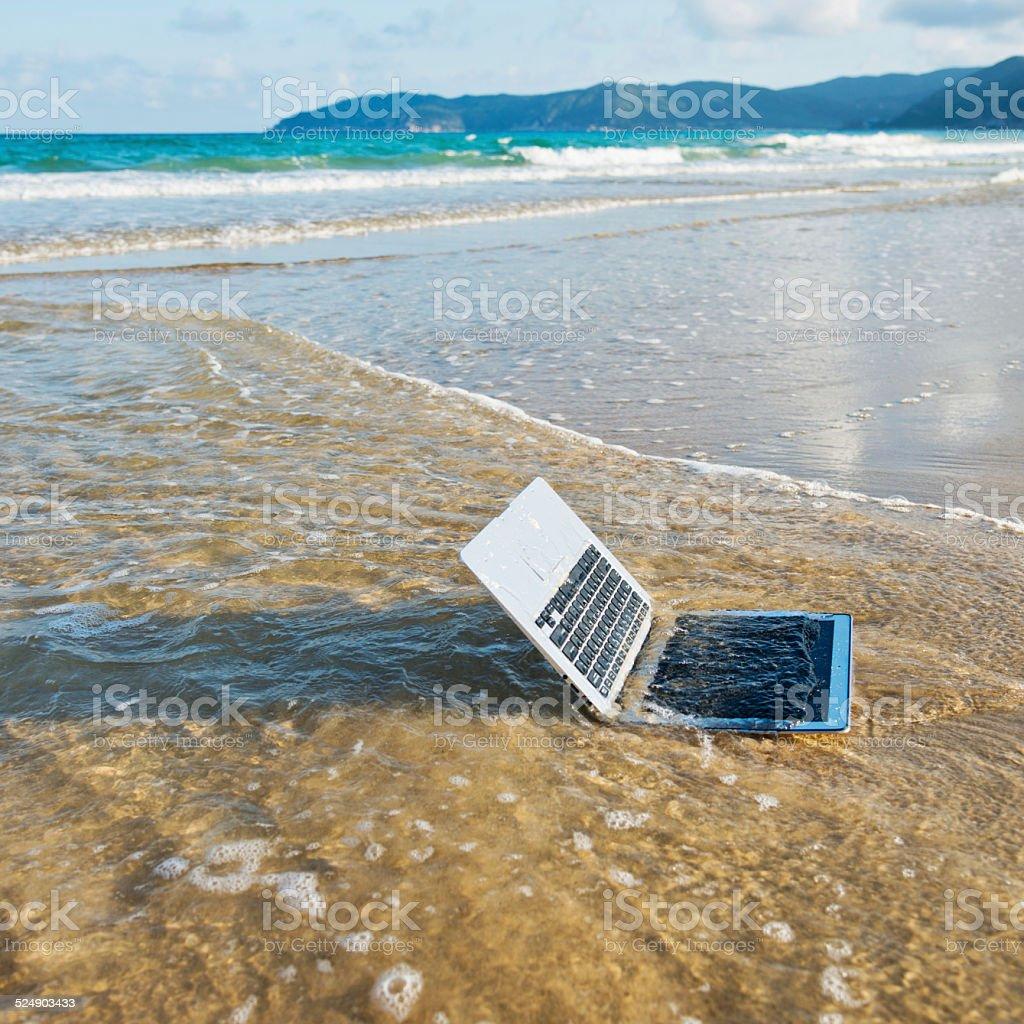 laptop on beach stock photo